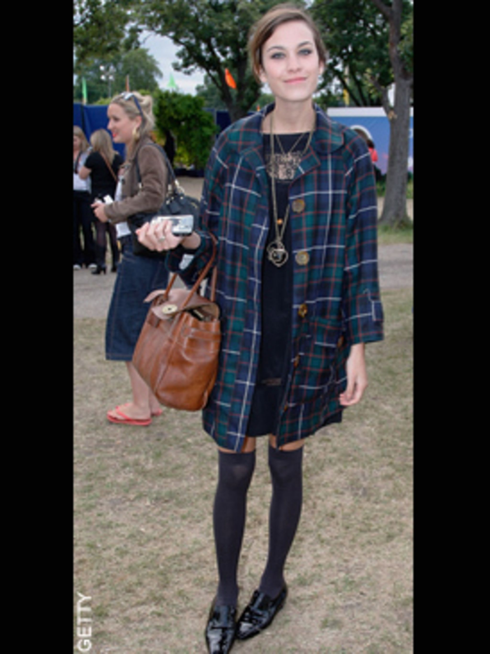 <p>Alexa Chung in the signature look she defined in 2008, granny meets school girl chic.</p>