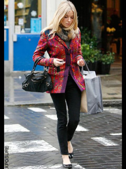 <p>Ms Miller beats the chill with a flash of colour with this rainbow-bright jacket worn over her trademark black skinny jeans </p>
