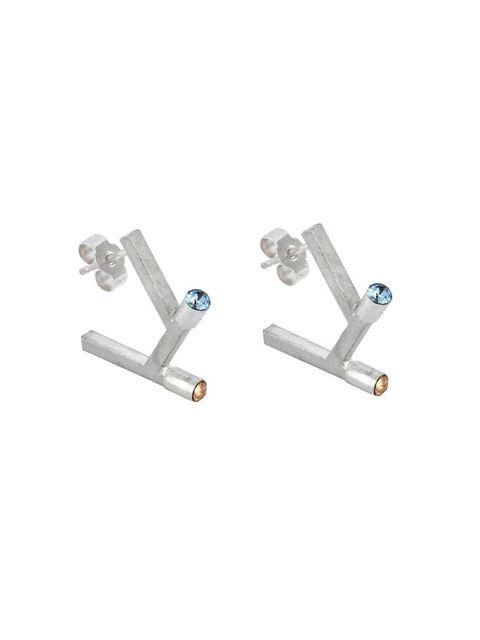 "<p><a href=""http://www.charlottevalkeniers.com/products/angle-earrings-silver"" target=""_blank"">Charlotte Valkeniers</a> earrings, £120</p>"