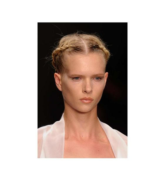 """<p>Whether you bother to plait or twist the sides, its the little detail that distracts from any further dishevelment. When the rest of the hair is perfectly sleek, any <a href=""""http://www.elleuk.com/style/street-style/weather-proof-your-look"""">weather</a>"""