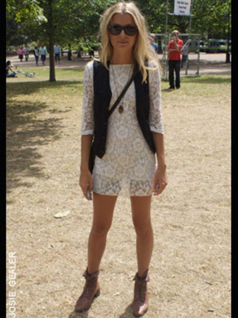 <p>Christina, 26, works in film, is wearing a cream lace dress brought from a shop in Brick Lane and a pair of vintage boots</p>