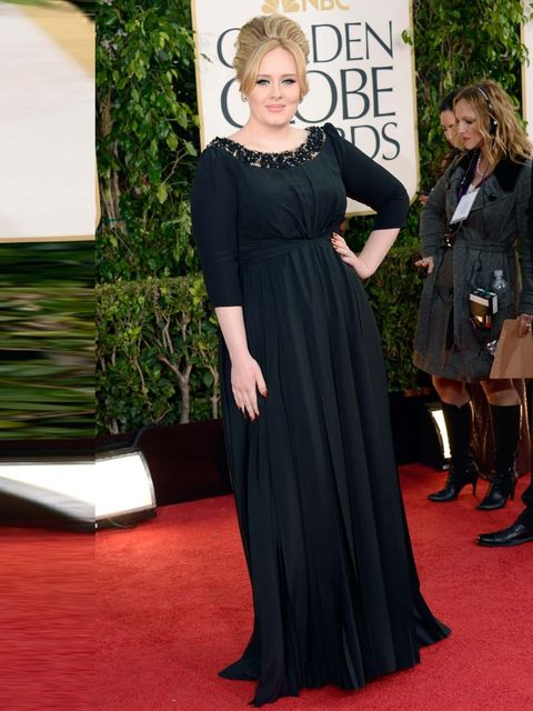 <p>Adele wore a black Burberry gown at the Golden Globe Awards 2013. </p>