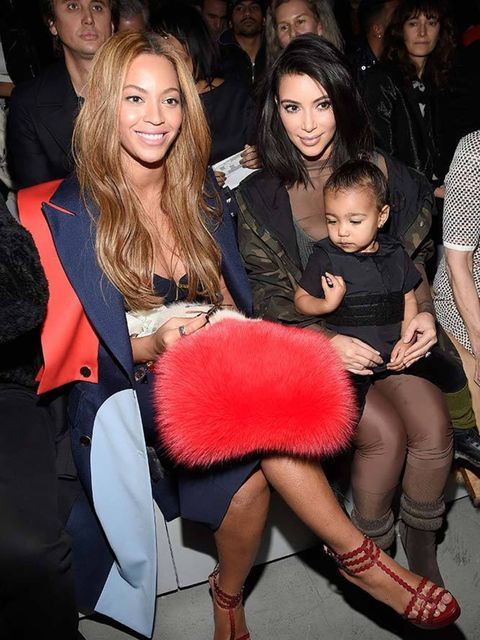North West (with Beyoncé and Kim) at adidas x Yeezy AW15.