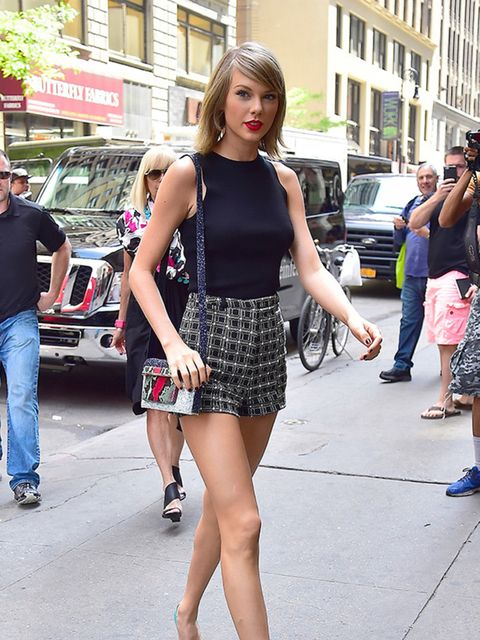 Taylor Swift is seen in Tribeca, NY, carrying the small MVK s/s 2015 bag in turquoise glitter, May 2015.