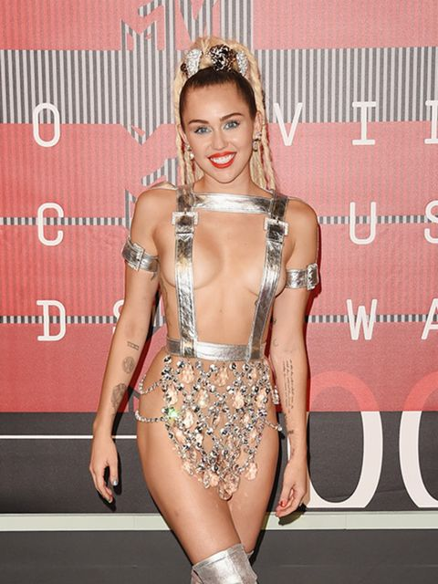 <p>Miley Cyrus in custom-made Versace</p>
