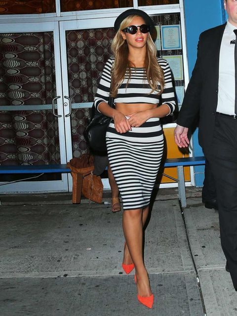 <p>Beyonce wears a monochrome striped bodycon skirt with matching crop top to Kanye West's birthday party in New York City.</p>