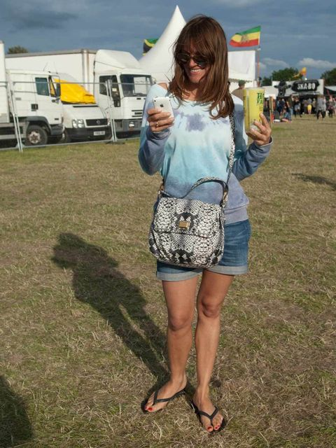 <p>Silvia, 42, fashion, London. Urban Outfitters jumper, Levi's shorts, Havaianas flip-flops, Marc by Marc Jacobs bag, Ray Ban sunglasses.</p>