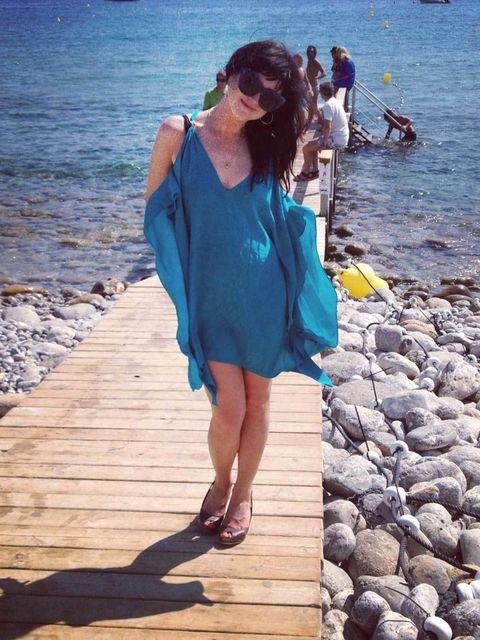 <p>Alannah wears a Lazul kaftan, Agent Provocateur bikini, House of Harlow sunglasses, Aldo wedges</p>