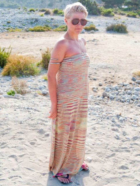 <p>Georgie, 27, London, Accountant. Odemal dress, Havaianas flip-flops, vintage sunglasses and necklace.</p>