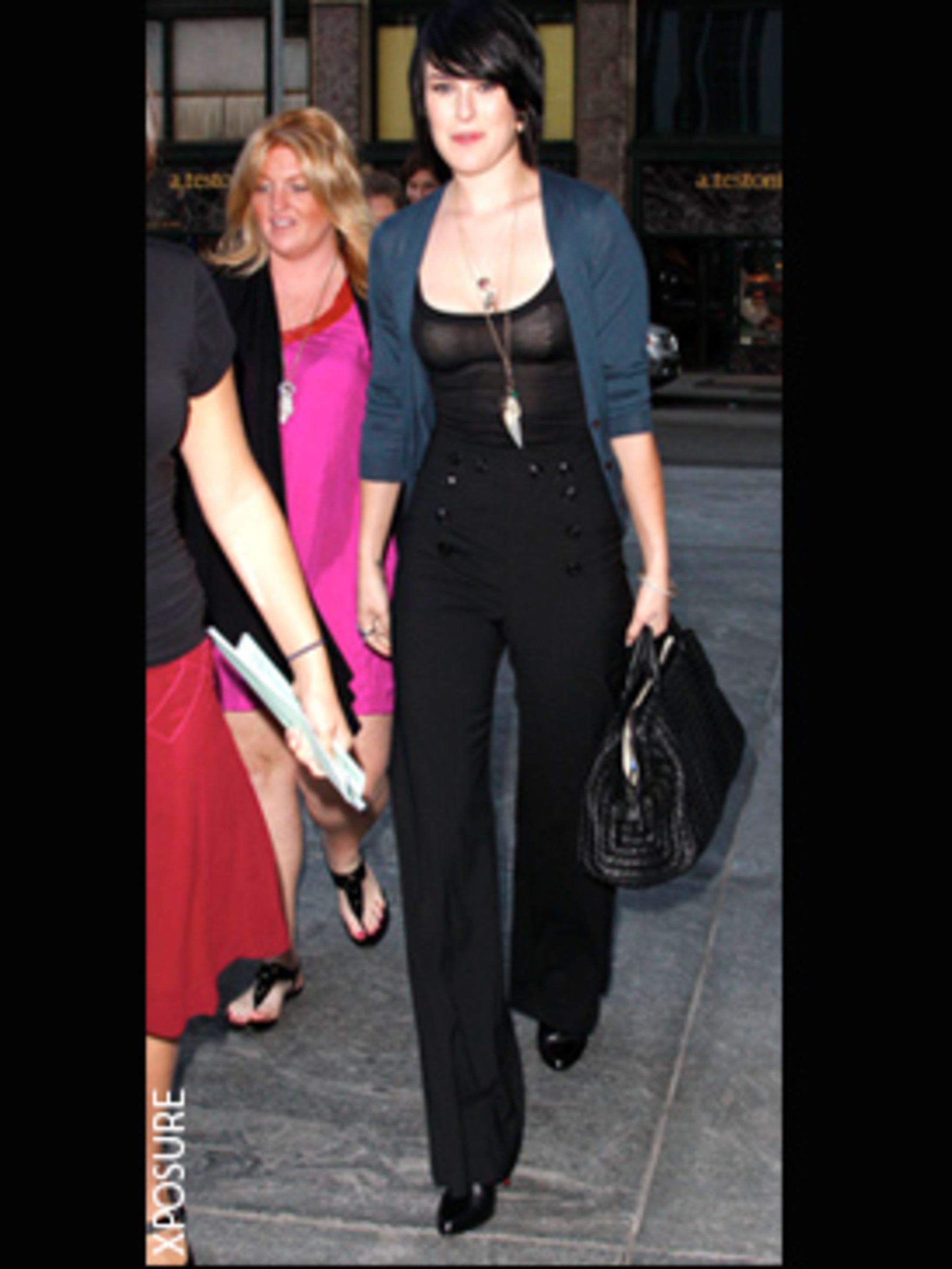 <p>Looking chic and sleek in high waisted black trousers in NYC</p>