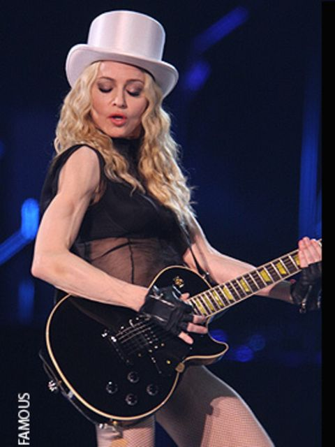 <p>Madonna wows the crowds in Cardiff in some of her most revealing stage costumes to date - this one really is underwear, fishnets and a silver top hat.</p>
