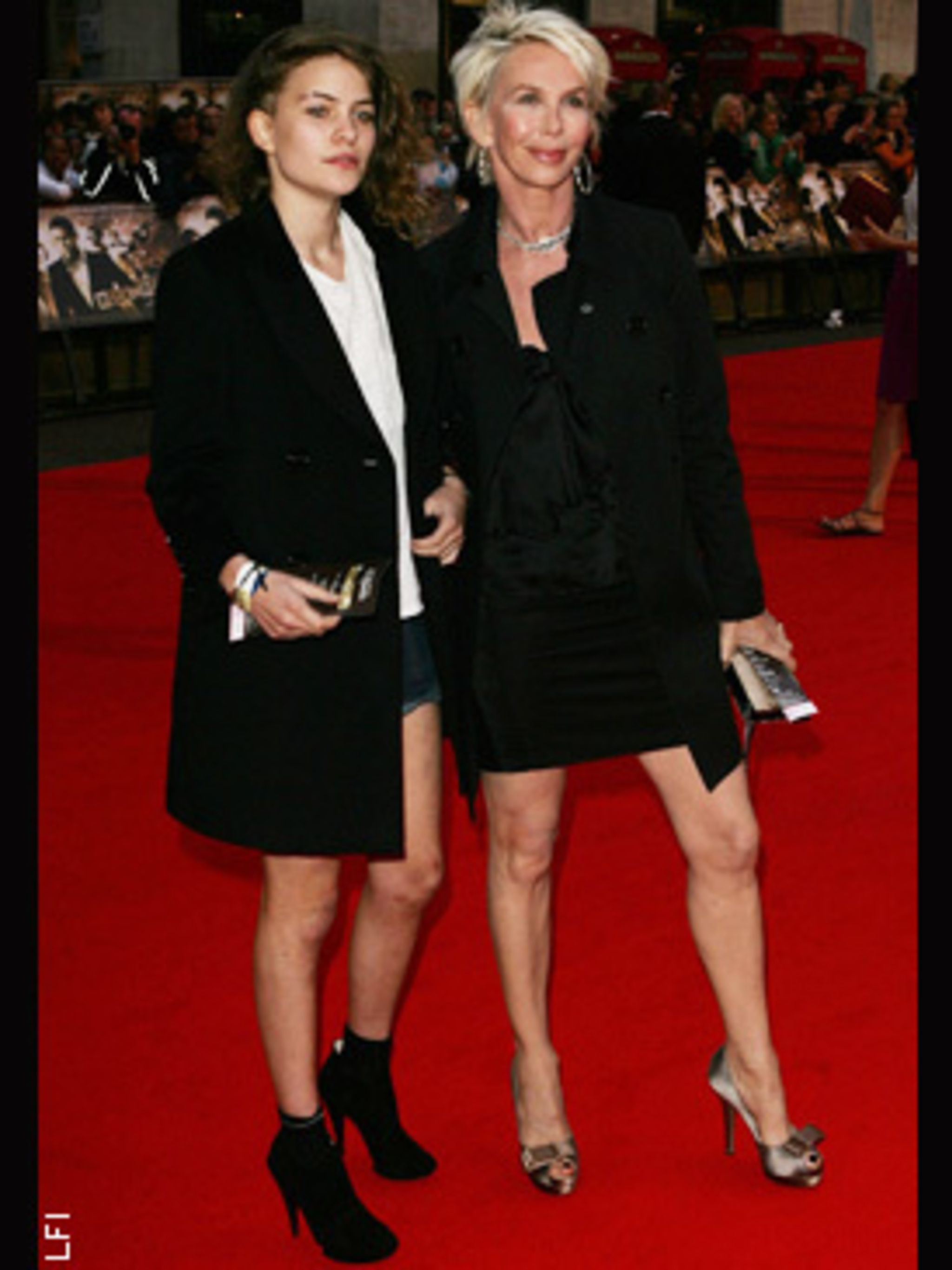<p>Coco rocks the red carpet in micro mini denim shorts and a long length Tuxedo jacket, alongside mum Trudie Styler</p>