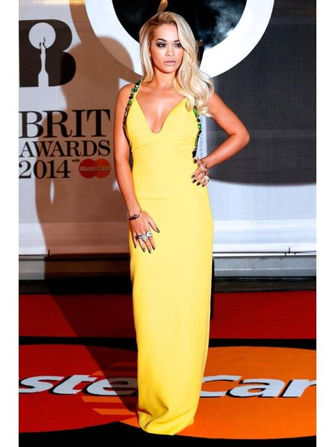 <p>Rita Ora wearing Prada. Rita gets her rocks on, on acid. She's not afraid to wear colour – and she can really pull it off. </p>