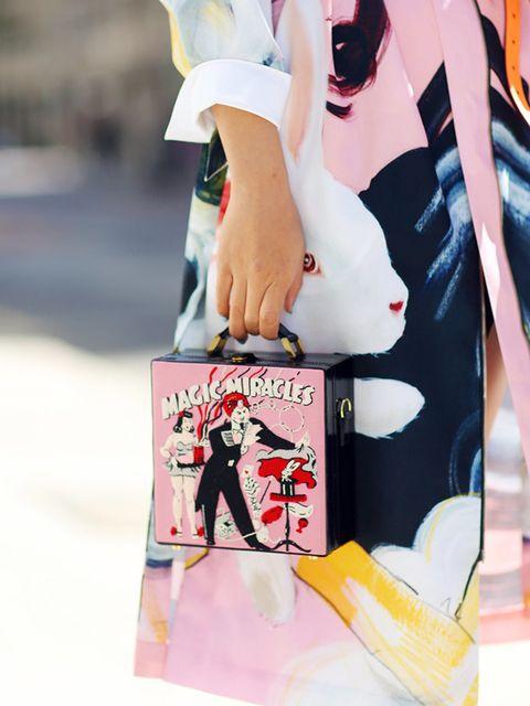 <p>Candi Li wears Olympia Le tan bag.</p>