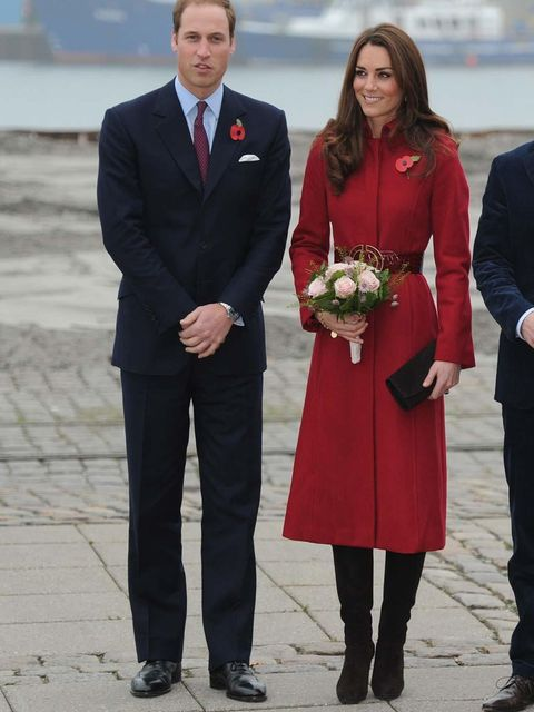 <p>Kate wore the same red LK Bennett coat on a visit to a UNICEF Emergency Supply Centre in Copenhagen with Prince William, this time accessorising with a black clutch and suede Stuart Weitzman boots.</p>