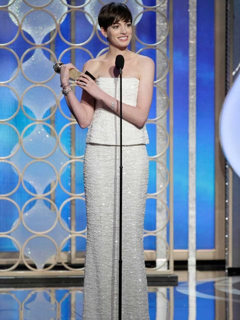 <p>Anne Hathaway collects her Best Supporting Actress award</p>