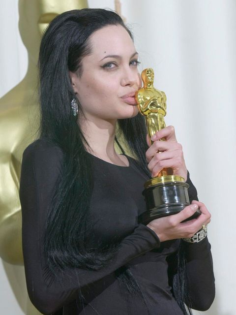 "<p><a href=""http://www.elleuk.com/star-style/news/oscars-2014-presenters-awards-brad-pitt-angelina-jolie-jennifer-lawrence-benedict-cumberbatch-amy-adams"">Angelina</a> puckers up those famous lips</p>"