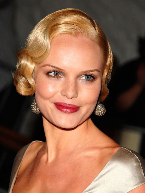 """<p><a href=""""http://www.elleuk.com/star-style/celebrity-style-files/kate-bosworth-style-icons-best-dressed-moments"""">Kate Bosworth</a> goes all-out 1920s with her waved updo and stained wine lip. Notice how the lip has a worn-in feel? Recreate this with blo"""