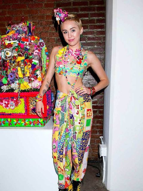 <p><strong>A headdress made out of dummies, sequinned bows, technicolour beads and a dangly 99</strong></p>