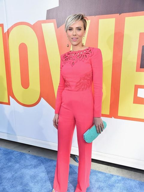 <p>Scarlett Johansson attends the MTV Movie Awards in Los Angeles in a Zuhair Murad jumpsuit and Sophia Webster shoes.</p>