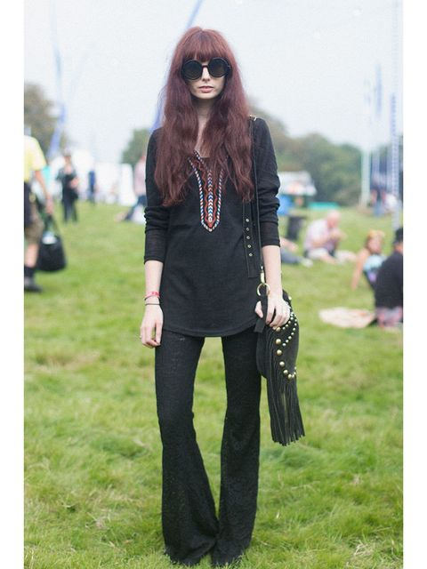 Emily Wood wears Vintage top and shoes, H&M trousers and Topshop bag.