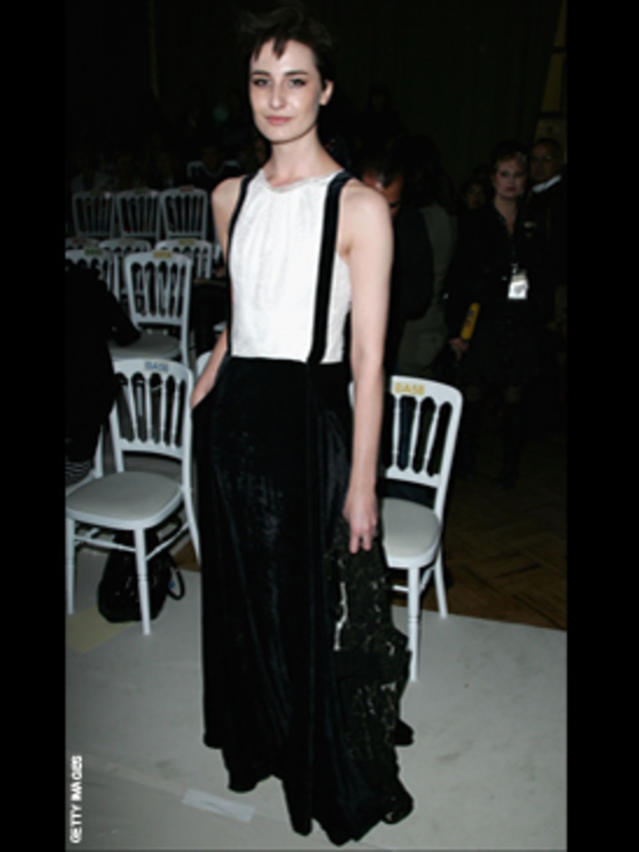 <p>Front row at London Fashion week Erin does her signature androygnous look in high waisted wide-leg wool pants</p>