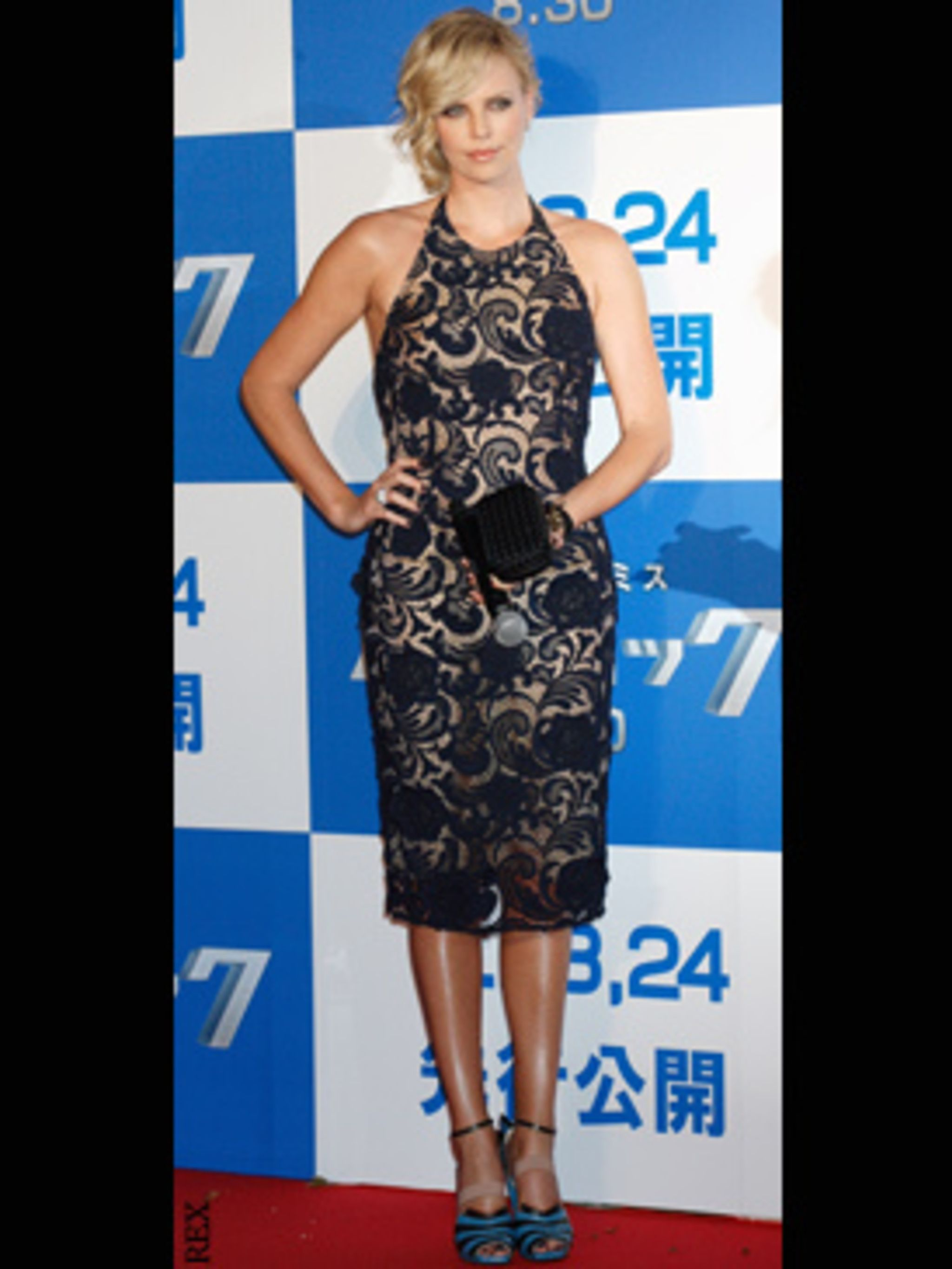 <p>Charlize Theron in this season's iconic Prada lace dress and sculptural stilettoes</p>