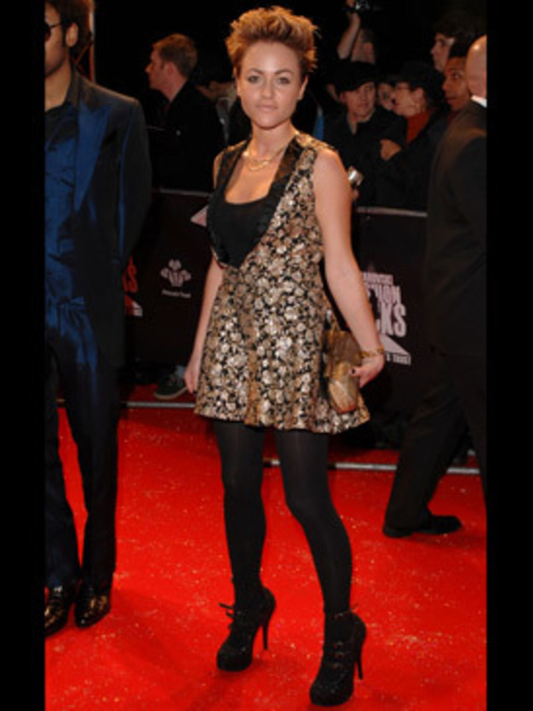 <p>Jaime cleverly teams her 'look at me' heels with opaques - magically lengthening her legs</p>