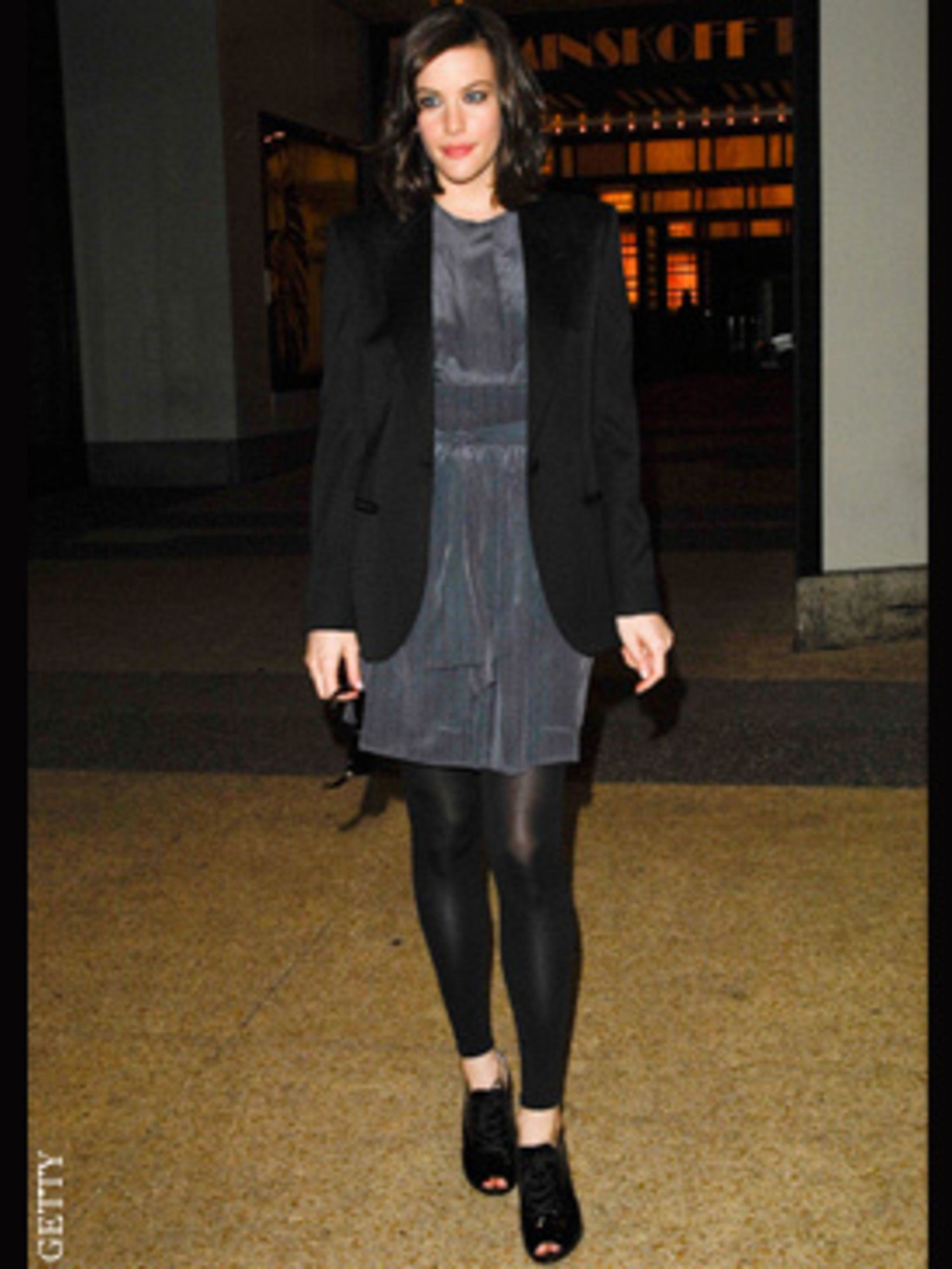 <p>Liv Tyler teams her Tuxedo jacket with a dress</p>