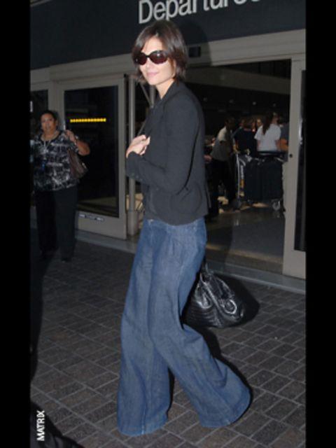 <p>Katie teams her wide, wide legs with a skinny, slimming blazer</p>