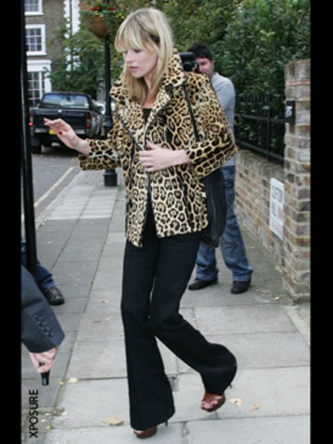 <p>Kate teams her wide legs with sexy heels and animal print for maximum impact</p>