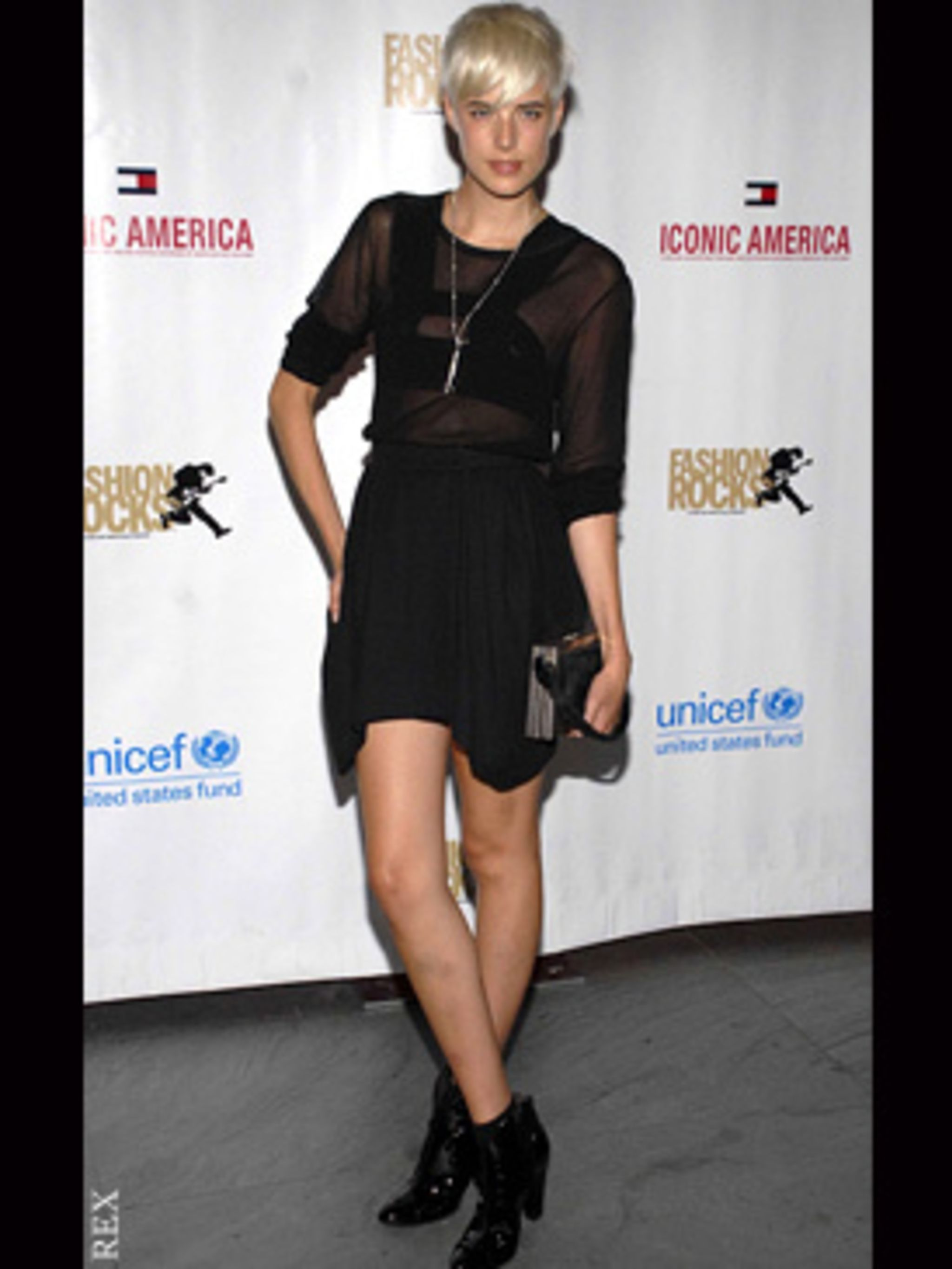 <p>Aggy obeys fashion's golden rule, if you are going to expose your legs, keep covered up on top</p>