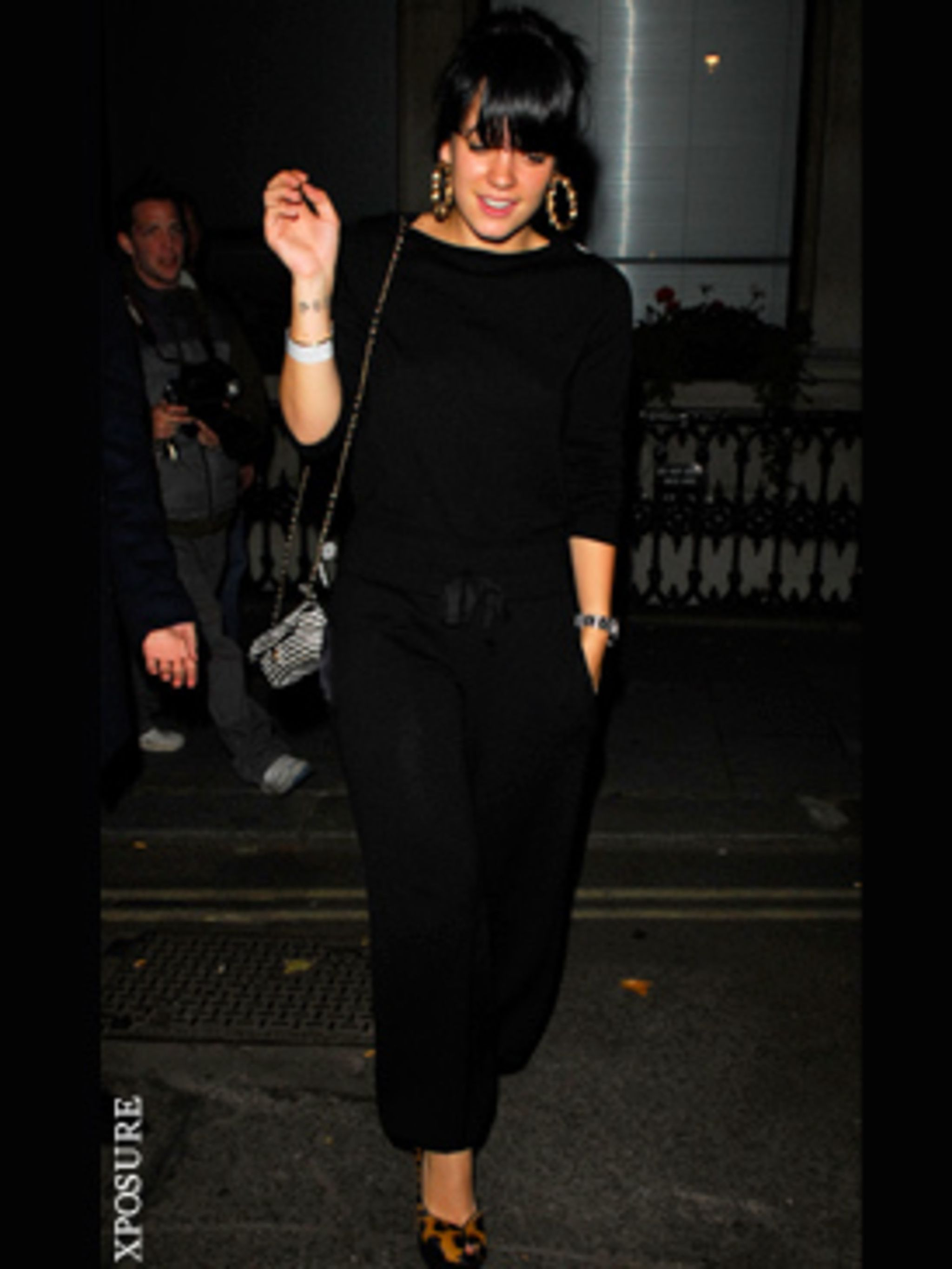 <p>Lily Allen teams her jumpsuit with some YSL Tributes</p>