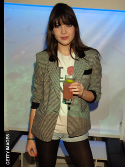 <p>Daisy's tweed jacket could look a bit country bumpkin but paired with a vintage T-shirt and denim shorts it's pure rock chic</p>