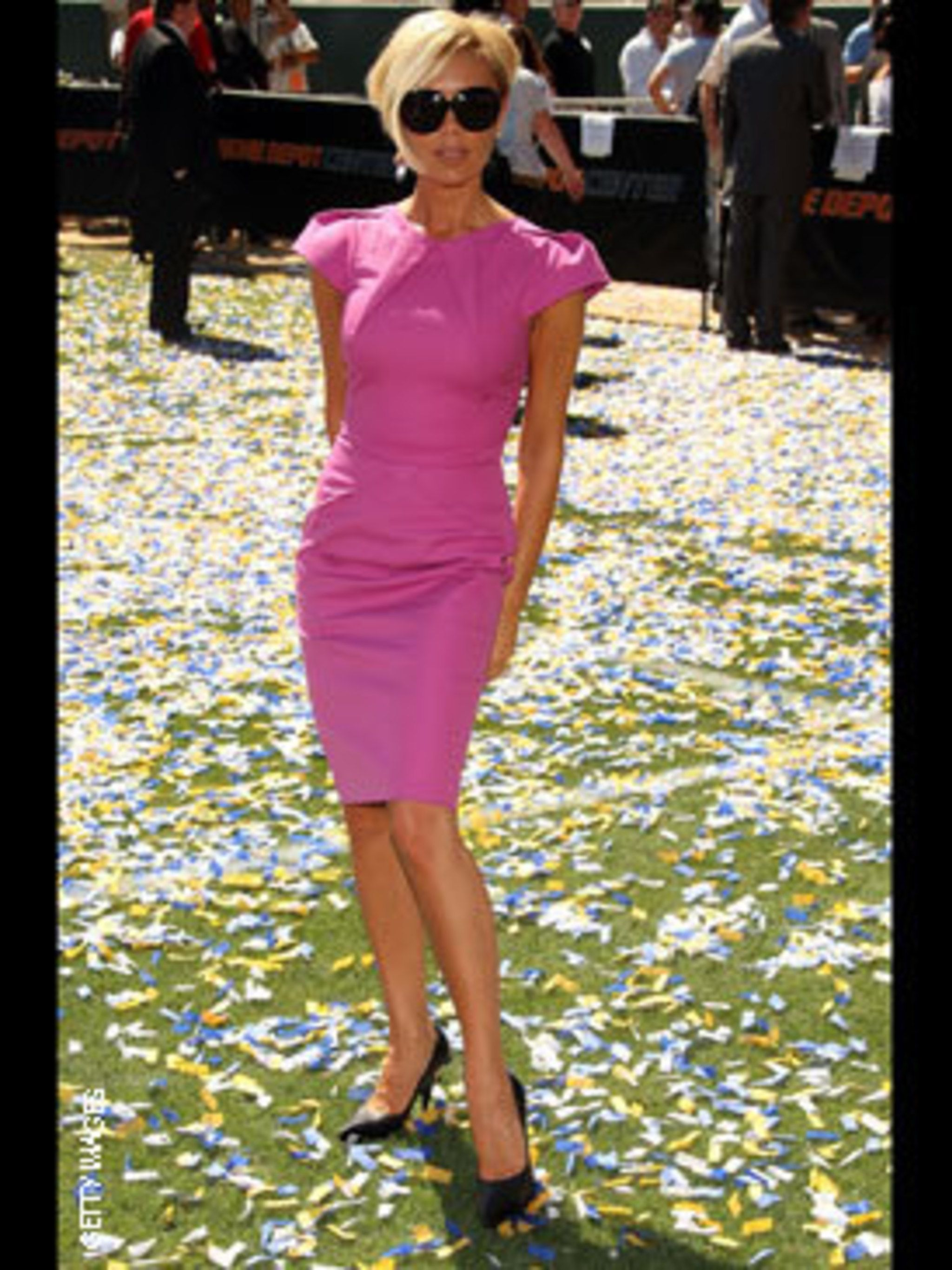 <p>Victoria never misses a key trend - and wears it so well in this Roland Mouret dress </p>