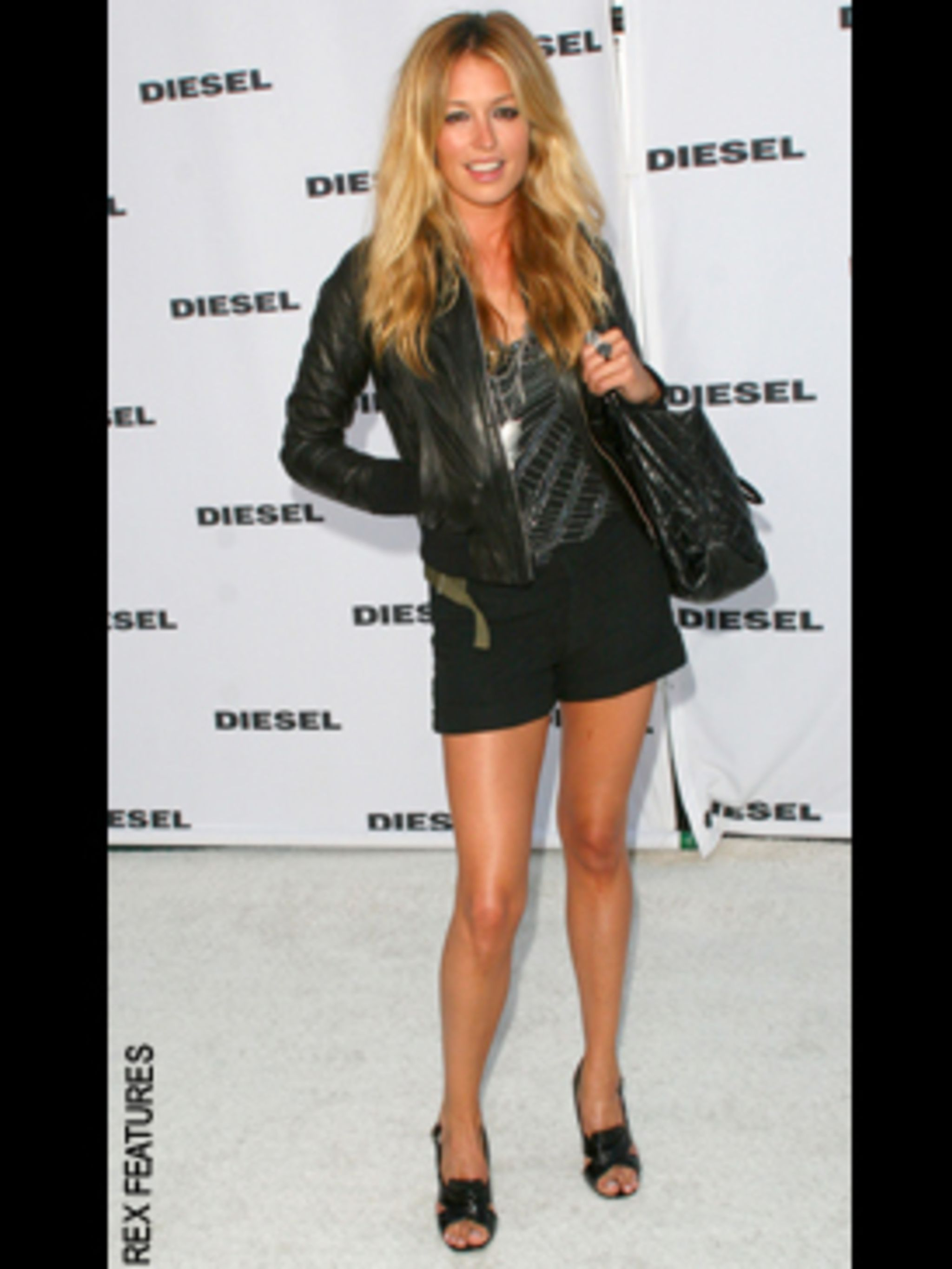 <p>Cat perfects the look in Diesel shorts and perfectly tanned legs</p>