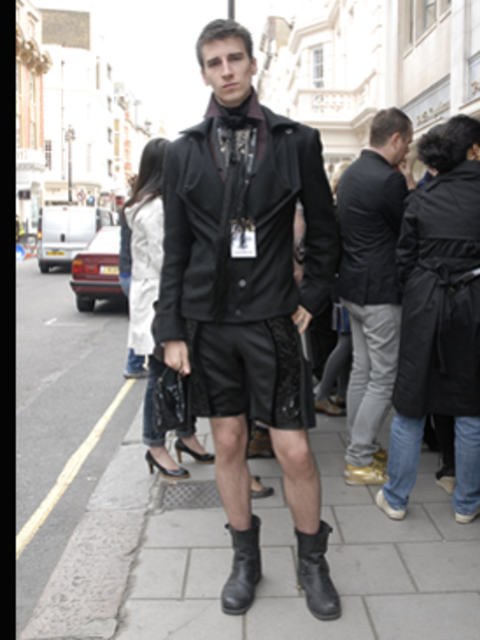 <p>We spotted Matthew, a designer, waiting for the Luella show at Claridges. Not content with any old suit, Matthew's has sequined panels. We love his Chloe inspired biker boots.</p>
