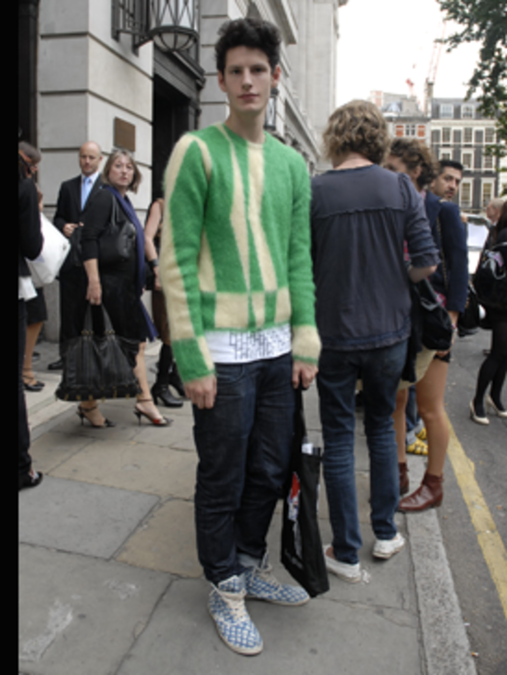 <p>Tom was flaunting a Prada-esque jumper and retro boots with a curious fish scale print at Bloomsbury Square before the Marios Schwab show.</p>