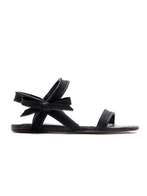 "<p>Black bow detail zip sandals, £320, by <a href=""http://www.viktor-rolf.com/index.htm"">Viktor & Rolf</a> </p>"