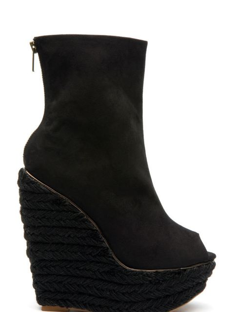 <p>Black wedge shoe boots, £65, by Mango (0207 434 3694)</p>