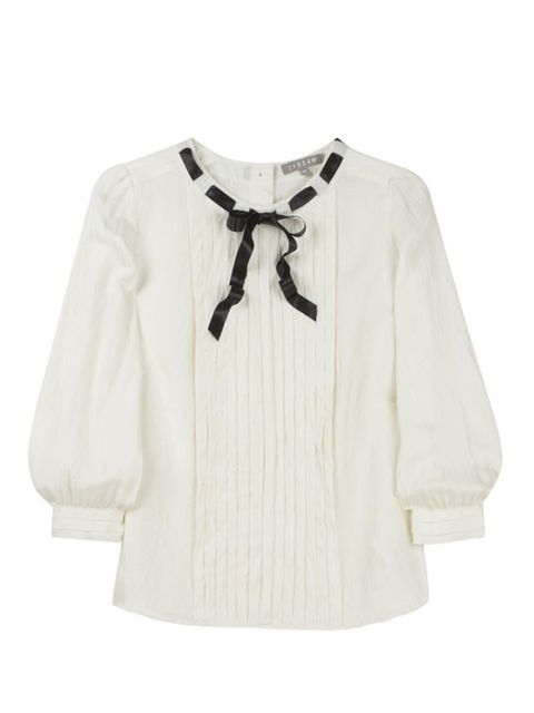 <p>Ribbon neck blouse, £89, by Jigsaw (0208 392 5603) </p>