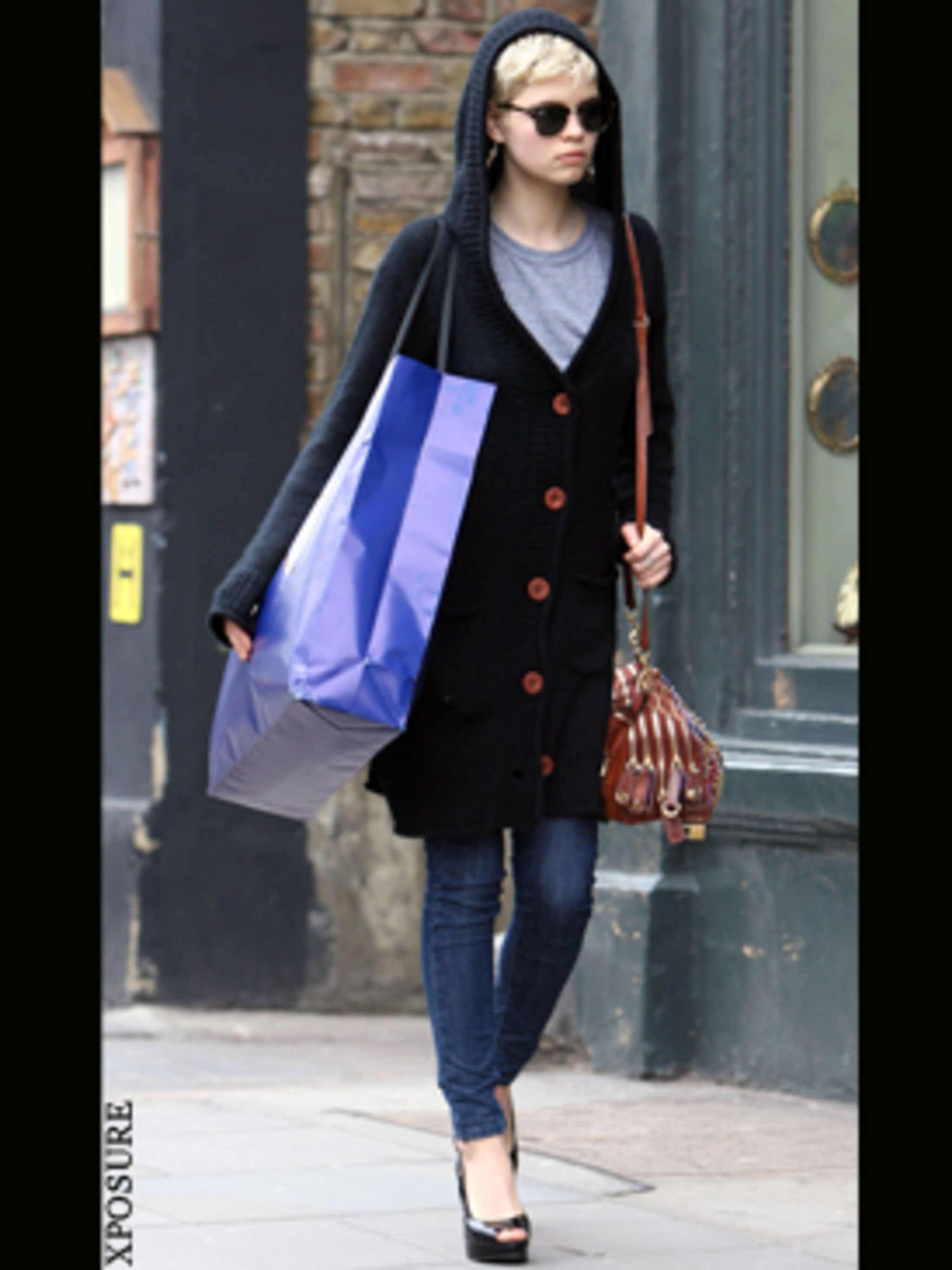 <p>Pixie has found the answer to London's transitional weather - a giant hoodie come knit.</p>