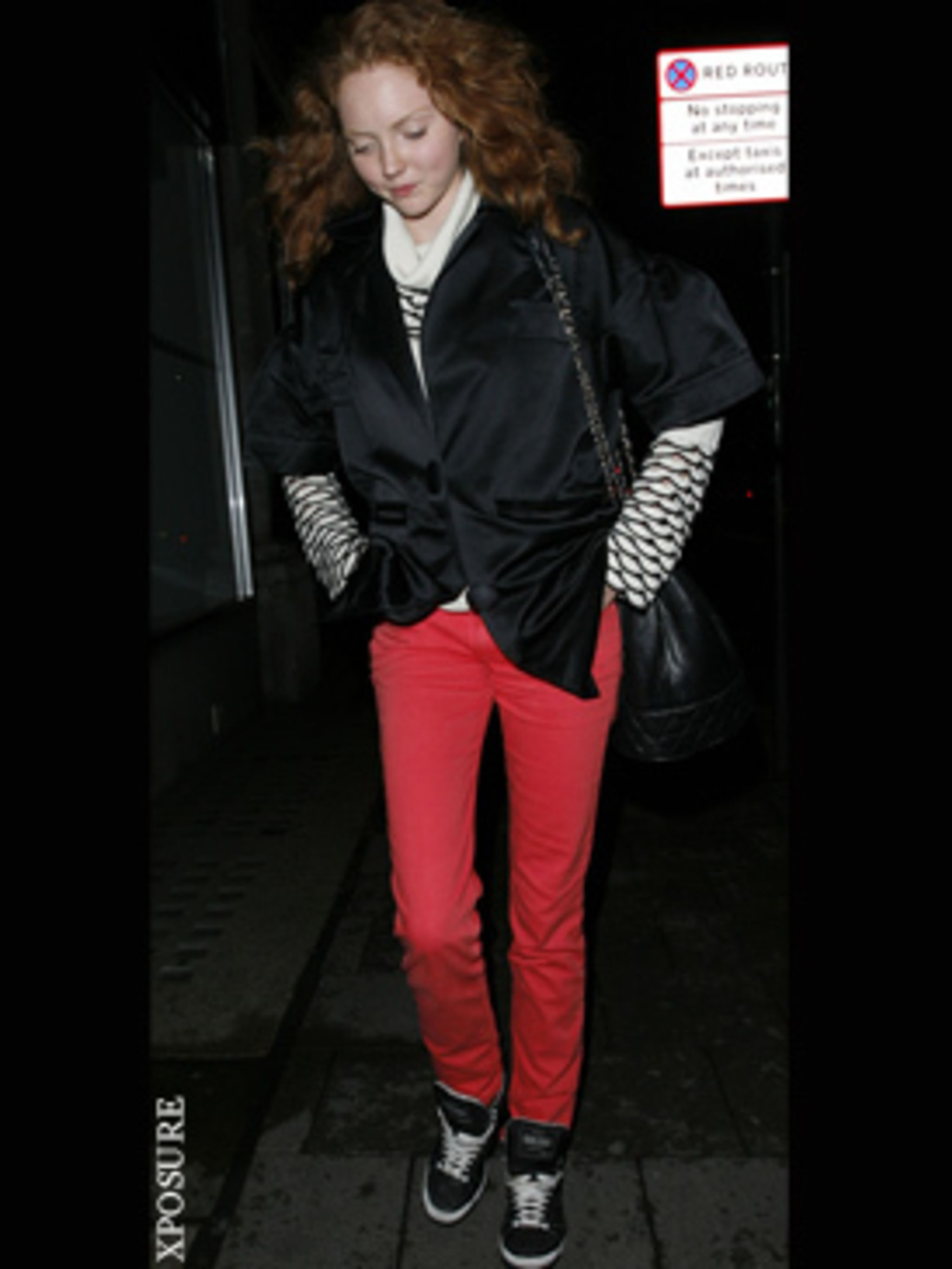 <p>Lily Cole in bright hot jeans</p>