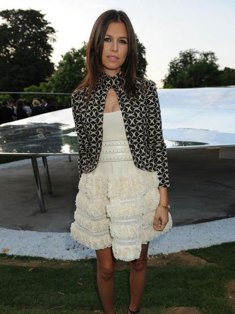 """<p>Dasha Zhukova attends the summer party at The Serpentine Gallery wearing a <a href=""""http://www.elleuk.com/catwalk/collections/dior/spring-summer-2009"""">Christian Dior</a> jacket with a cream ruffled dress and open peep toe shoes, July 2009,</p>"""