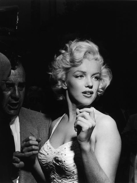 <p>Monroe surrounded by reporters and fans outside Grauman's Chinese Theater in Hollywood, California, 1953</p>
