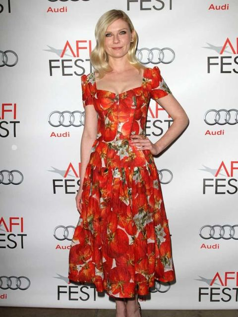 """<p>Kirsten Dunst wears a tomato printed <a href=""""http://www.elleuk.com/catwalk/collections/dolce-gabbana/"""">Dolce & Gabbana</a> S/S 12 dress with black strappy sandals for the premiere of 'Melancholia' in California, November 2011.</p>"""
