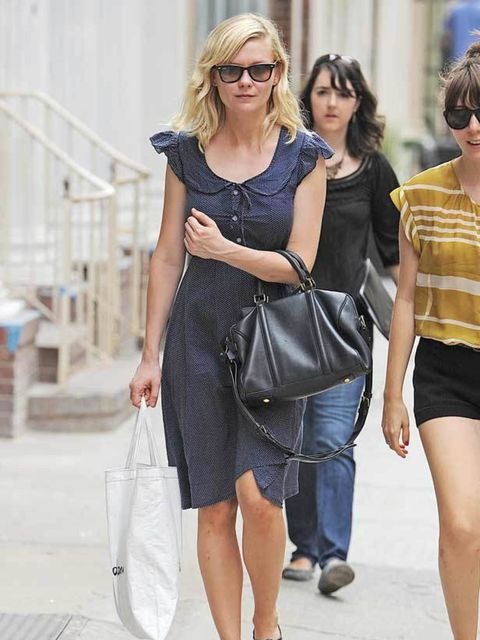 <p>Kirsten Dunst was spotted in this navy tea dress whilst shopping in New York, July 2011.</p>