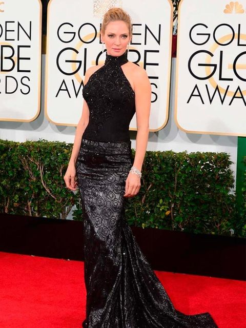 <p>Uma Thurman wears Versace to the 71st Annual Golden Globe Awards, 2014.</p>