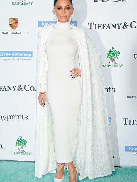 Nicole Richie wore a white Tadashi Shoji Cape, White H&M Dress and Christian Louboutin shoes to the Baby2Baby gala in Los Angeles, November 2014.