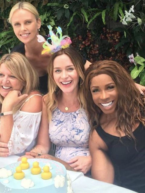 Charlize Theron threw Emily Blunt  a baby shower. Friendship goals.